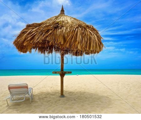 Aruba Beach with blue sky and green sea