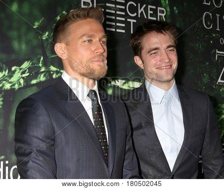 LOS ANGELES - APR 5:  Charlie Hunnam, Robert Pattinson at the