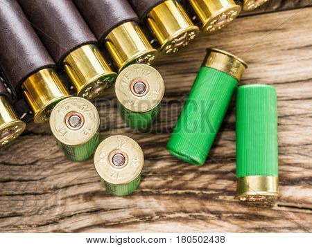 Hunting cartridge for pump shotgun on the wooden table.