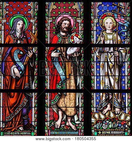 Stained Glass In Brussels Sablon Church - Saints Colette, John The Baptist And Emmanuel