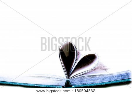 Love concept book pages curved into heart isolated on white background