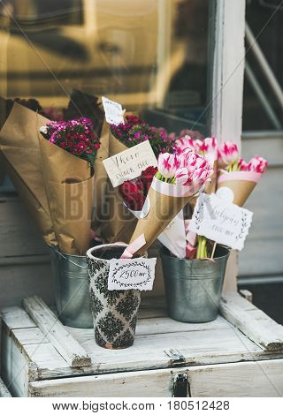 BUDAPEST, HUNGARY - MARCH 23, 2017: Colorful flowers bouquets at entrance to small artisan street flower shop at Kiraly Street in old town center of Budapest, Pest side, 7th district
