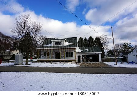 HARBOR SPRINGS, MICHIGAN / UNITED STATES - NOVEMBER 21, 2016: A home under construction on Washington Street in Harbor Springs.
