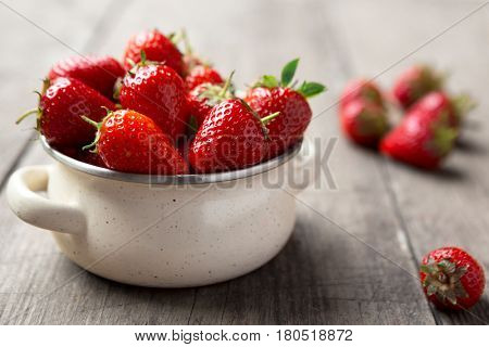 freshly picked strawberries in the bowl on table