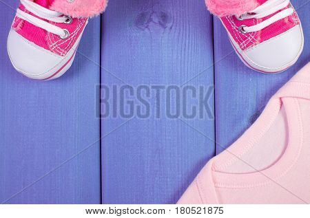 Shoes And Bodysuits For Newborn, Expecting For Baby, Copy Space For Text On Wooden Boards