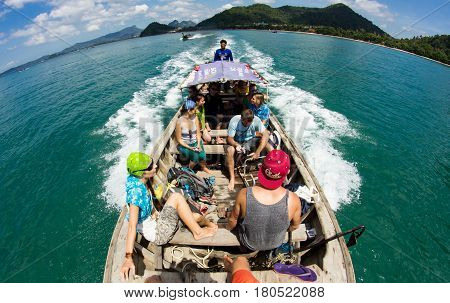 KRABI THAILAND 30 OCTOBER 2012 : Company of young people going to adventure to Tonsai and Railay beaches at Krabi Province by traditional thai long-tail boat.