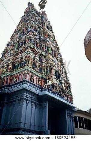 The Raja Gopuram tower, decorated with sculptures of Hindu gods, at the Sri Mahamariamman Temple, built in 1873 in Kuala Lumpur, Malaysia.