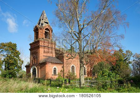 The ancient Transfiguration Church (1871) in the village of Chernavino on a sunny September day. Leningrad region, Russia