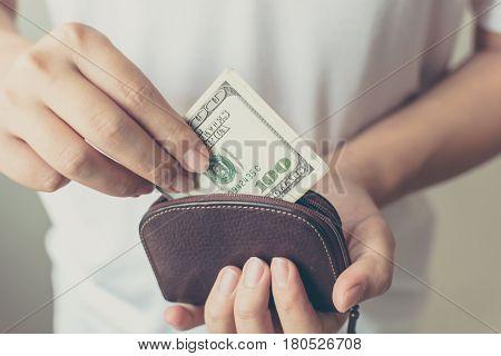Hand holding money dollar bill in wallet