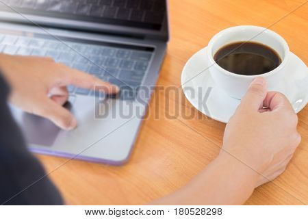 Hand On Hot Cup Of Coffee stock photo