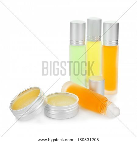 Bottles and containers with perfume on white background