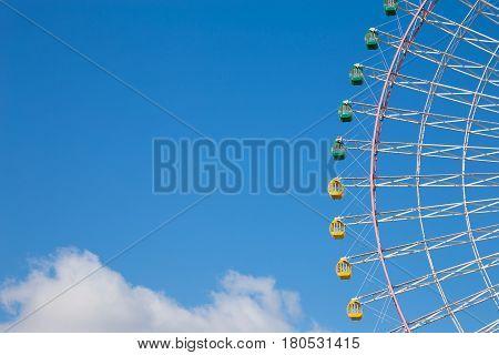 Big festival funfair ferris wheel against blue sky background