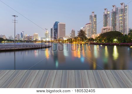 Opening wooden floor City office building light with water reflection in public park