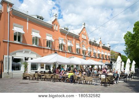 TURKU, FINLAND - JUNE 13, 2015: Open-air cafe on the street of Turku in the sunny June afternoon