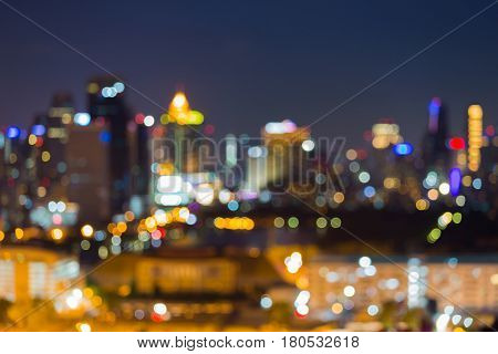 Abstract blurred bokeh light city office building with twilight sky background