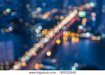 Blurred bokeh light aerial view city road at twilight abstract background