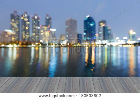 Opening wooden floor Twilight blurred bokeh office building with reflection abstract background