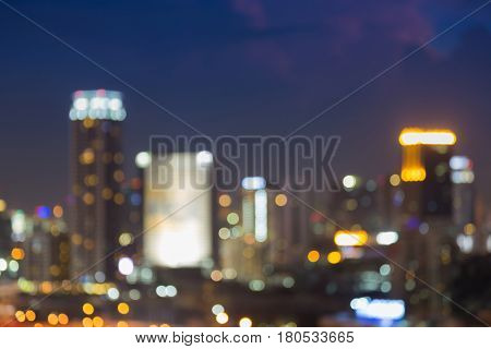 Night blurred bokeh light city office building abstract background