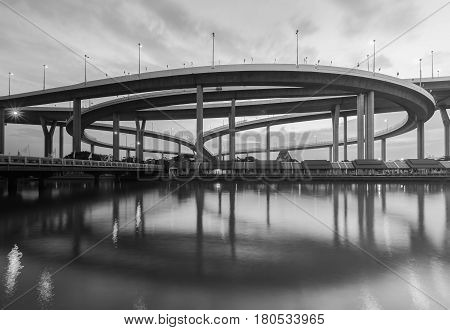 Black and White Round highway overpass interchanged river front and reflection