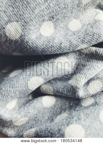 Textile fabric background. Simple everyday dotted polka clothers