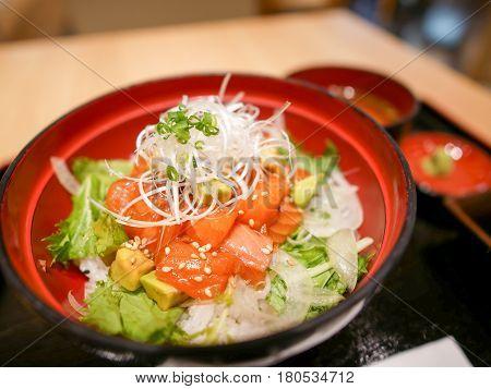 Salmon Donburi aka fresh and raw salmon served on rice with avocado and vegetable.