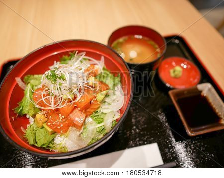 Salmon Donburi aka fresh and raw salmon served on rice with avocado and vegetable.