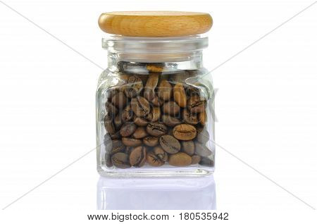 Coffee beans in a glass jar with wooden bung. Isolated on white background