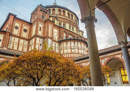 Milan, Italy - November 15, 2016: Church Santa Maria Delle Grazie in Milan, shot from courtyard in autumn. it's hosting in the refectory: The Last Supper mural painting by Leonardo da Vinci.