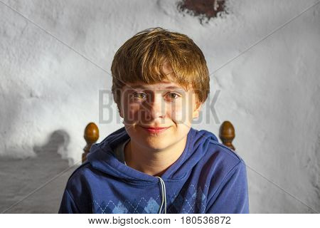 portrait of cute young boy in a restaurant
