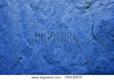Abstract dark blue texture. Dark blue paper background. Abstract  background and texture for designers. Old vintage recycled paper. Navy blue abstract background. Dark blue rough paper.