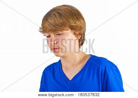 portrait of boy in sorrow in blue shirt