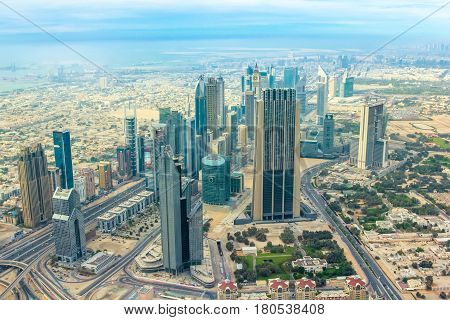 Dubai, United Arab Emirates - May 1, 2013: Scenic view of skyscrapers of Dubai downtown skyline on Sheikh Zayed Road, in the United Arab Emirates from the top.