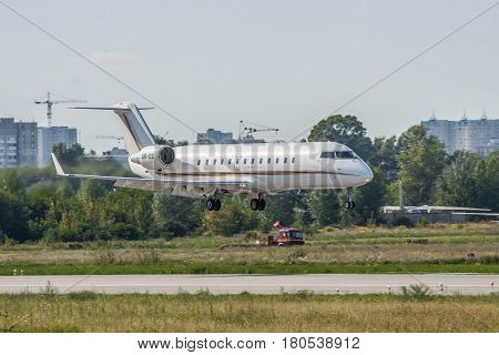 Kiev Ukraine - August 19 2011: Bombardier CL-600-2B19 Challenger 850 business jet is landing in the airport on a sunny day