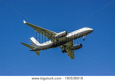 Kiev Region Ukraine - June 9 2011: Tu-204-300A passenger plane is landing with the blue clear sky on the background