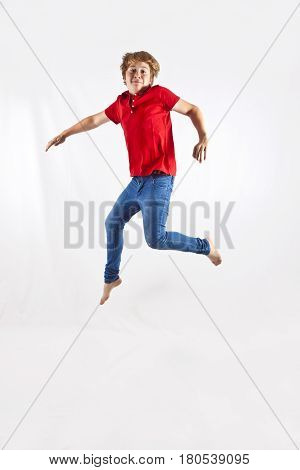 portrait of cute boy jumping in the air