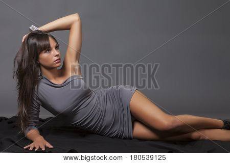 Girl in dress posing in the studio