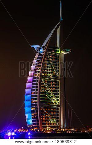 Dubai, UAE - May 3, 2013: night view of Burj Al Arab a 7 stars hotel built on an artificial island near Jumeirah beach. The Arab Sail is the tallest hotel in the world and the most luxurious Dubai.