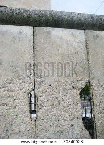 BERLIN, GERMANY - JULY 20, 2016: Part of famous Berlin Wall in downtown Berlin, Germany. Historical symbol between East and West Berlin after Second World War and Cold War