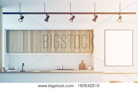 Close up of a white kitchen with a bar and light wooden furniture. There is a blank framed poster on a wall. 3d rendering mock up toned image