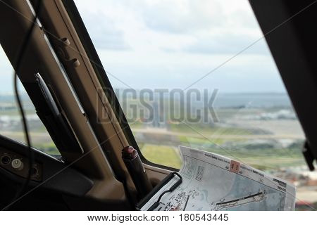 View from a flight deck window on a runway just before landing to Australia Sydney Kingsford Smith International Airport