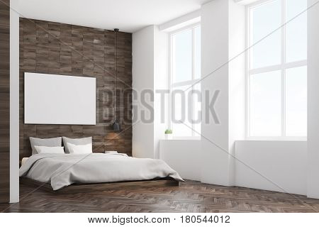 Side view of a bedroom with dark wooden walls a double bed with gray bedding and a large horizontal poster hanging above it. 3d rendering mock up