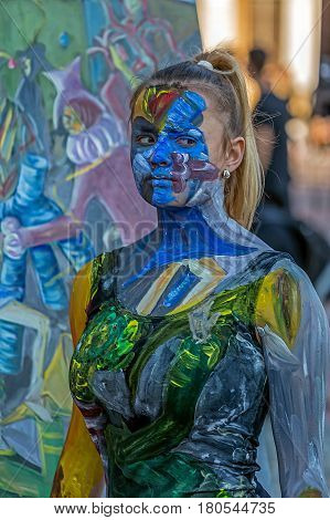 TIMISOARA ROMANIA - MARCH 31 2017: Face and body painting of a woman. 3D art symbolizing on live at the street inside the CheckART Carnival organized by the City Hall Timisoara. Liberty Square.