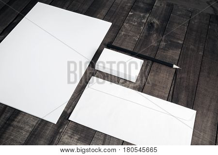 Photo of blank corporate identity. Stationery set. Branding mockup. Sheet of paper letterhead business cards envelope and pencil.