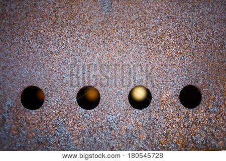 Rusty metal background. Close-up of old rusty brazier with round holes.