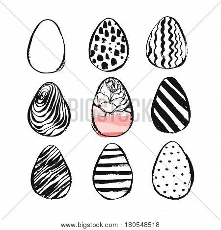 Hand drawn vector abstract Easter brush painted eggs collection set with floral motif in black and white colors isolated.Easter spring decoration background.Easter design elements.Eggs hunt concept.