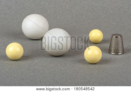 a thimble and balls for gambling of different size and color