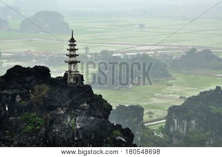 Panorama View Of Rice Fields, Rocks And Mountaintop Pagoda From Hang Mua Temple Viewpoint