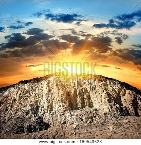Scenic yellow rock in the rays of evening sun