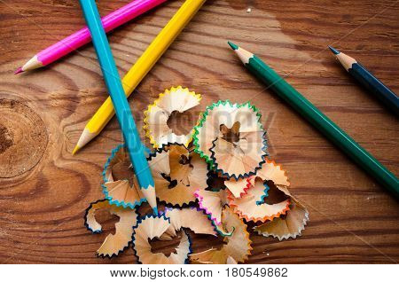 coloring pencils sharpening single a wooden board background
