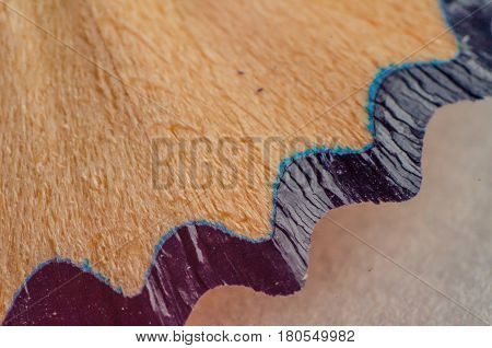 coloring pencils sharpening single a wooden background. closeup